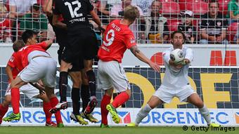 MAINZ, GERMANY - AUGUST 11: Goalkeeper Heinz Mueller of Mainz makes a save against Benedikt Roecker of Stuttgart during the Bundesliga match between 1. FSV Mainz 05 and VfB Stuttgart at Coface Arena on August 11, 2013 in Mainz, Germany. (Photo by Alex Grimm/Bongarts/Getty Images)