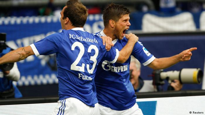 Schalke 04's Christian Fuchs (L) and Klaas-Jan Huntelaar celebrate a goal against Hamburg SV during the German first division Bundesliga soccer match in Gelsenkirchen August 11, 2013. (Photo via REUTERS/Ina Fassbender)