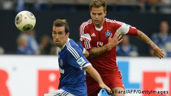Schalke's Austrian defender Christian Fuchs and Hamburg's defender Dennis Diekmeier (R) vie for the ball during the German first division Bundesliga football match FC Schalke 04 vs Hamburger SV in the German city of Gelsenkirchen on August 11, 2013. AFP PHOTO / PATRIK STOLLARZ RESTRICTIONS - DFL RULES TO LIMIT THE ONLINE USAGE DURING MATCH TIME TO 15 PICTURES PER MATCH. FOR FURTHER QUERIES PLEASE CONTACT DFL DIRECTLY AT + 49 69 650050. (Photo credit should read PATRIK STOLLARZ/AFP/Getty Images)