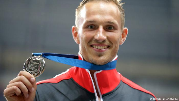 Michael Schrader of Germany poses with his silver medal on the podium after the Decathlon event at the 14th IAAF World Championships in Athletics at Luzhniki Stadium in Moscow, Russia, 11 August 2013. Photo: Michael Kappeler/dpa