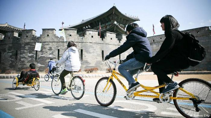Local youths take a bicycle tour around Hwaseong Fortress on 'Independence from Cars' event. Foto: Suwon City, 01.03.13, Hwaseong Fortress, Haenggung-dong, Suwon, South Korea.