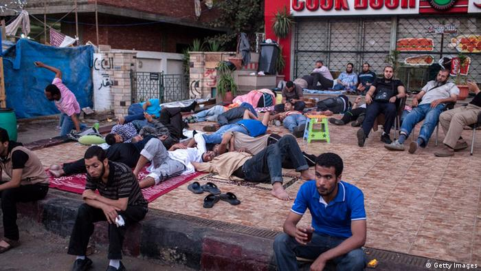Morsi supporters sleeping on rugs and sitting in chairs at a protest camp (photo: Ed Giles/Getty Images)