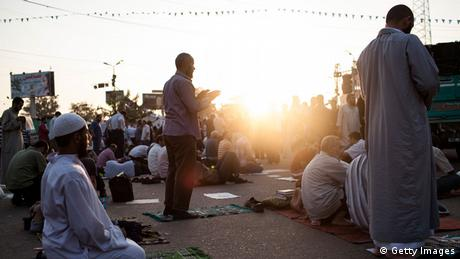 Sunset with praying men at Islamist protest camp (photo: Ed Giles/Getty Images)