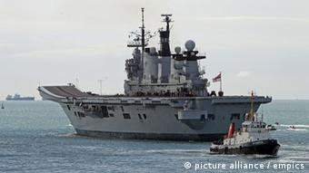 Gibraltar tensions. Helicopter carrier HMS Illustrious leaves Portsmouth to take part in a deployment codenamed Cougar '13 in the Mediterranean and the Gulf. Picture date: Monday August 12, 2013. See PA story POLITICS Gibraltar. Photo credit should read: Steve Parsons/PA Wire URN:17299286
