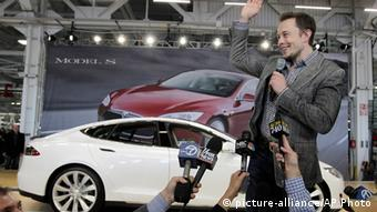 Tesla CEO Elon Musk waves during a rally at the Tesla factory in Fremont, California
