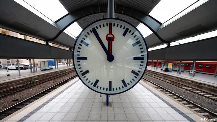 A station clock is pictured at a platform of the main train station in Mainz August 12, 2013.