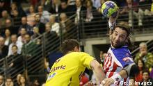 BERLIN, GERMANY - MARCH 24: Ivano Balic (R) of Madrid challenges for the ball with Denis Spoljaric (L) of Berlin during the HBL Champions League round of sixteen game between Fuechse Berlin and Atletico Madrid at Max Schmeling hall on March 24, 2013 in Berlin, Germany. (Photo by Matthias Kern/Bongarts/Getty Images)