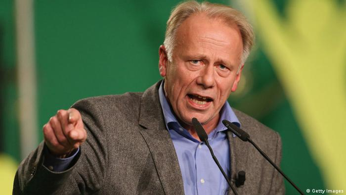 HANOVER, GERMANY - NOVEMBER 16: German Greens Party (Buendnis 90/Die Gruenen) co-chancellor candidate Juergen Trittin speaks to delegates at the Greens Party federal convention on November 16, 2012 in Hanover, Germany. Germany faces federal elections in 2013 and the Greens Party, which is Germany's third most popular party, could well become a government coalition partner. (Photo by Sean Gallup/Getty Images)
