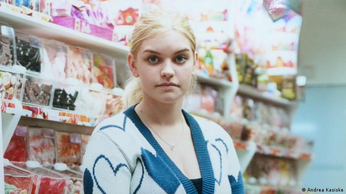 A young, blond saleswoman in a supermarket, part of the I am not afraid of anything photography exhibition by Edgar Zippel in Berlin's Museum for European Cultures, Copyright: Museum Europäischer Kulturen