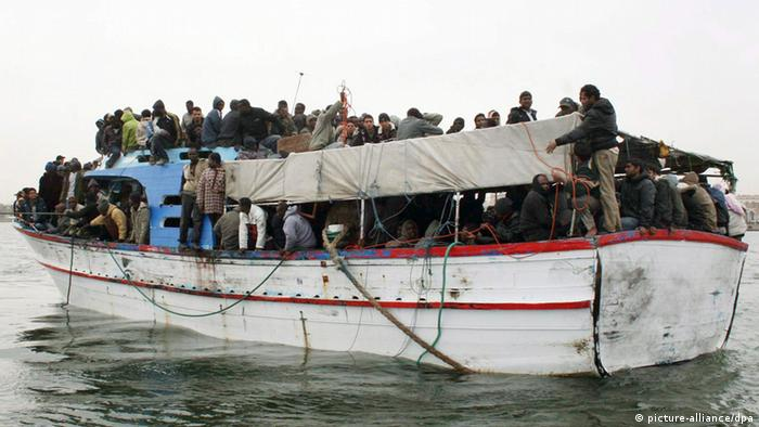 An image made available on 1st April shows an overcrowded boat with African migrants who were rescued when migrant boats capsized in stormy seas off the coast of Libya arrives in Tripoli, Libya (photo via dpa)