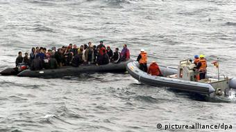 A boat of refugees in the water