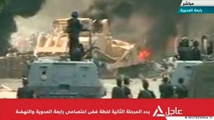 ACHTUNG VIDEOSTILL SCHLECHTE QUALITÄT NICHT ALS ARTIKELBILD VERWENDEN A bulldozer demolishes a barricade at a protest camp set up by supporters of deposed Egyptian President Mohamed Mursi in Cairo August 14, 2013 in this still image taken from video. Egyptian security forces finished breaking up the smaller of two Cairo protest camps set up by supporters of deposed President Mohamed Mursi, state TV reported on Wednesday, after the police moved in the early hours against the sit-ins. REUTERS/Nile TV via Reuters TV (EGYPT - Tags: CIVIL UNREST POLITICS TPX IMAGES OF THE DAY) ATTENTION EDITORS - THIS IMAGE WAS PROVIDED BY A THIRD PARTY. FOR EDITORIAL USE ONLY. NOT FOR SALE FOR MARKETING OR ADVERTISING CAMPAIGNS. NO SALES. NO ARCHIVES. EGYPT OUT. THIS PICTURE IS DISTRIBUTED EXACTLY AS RECEIVED BY REUTERS, AS A SERVICE TO CLIENTS. NO COMMERCIAL OR EDITORIAL SALES IN EGYPT