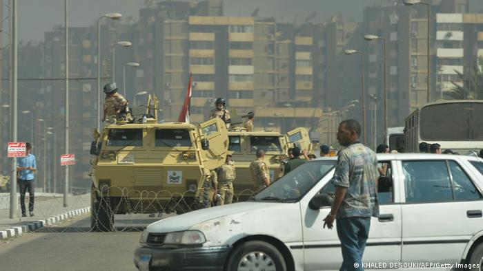 Egyptian military vehicles block a road leading to the Rabaa al-Adawiya protest camp in Cairo as Egyptian police try to disperse supporters of Egypt's ousted president Mohamed Morsi on August 14, 2013. KHALED DESOUKI/AFP/Getty Images