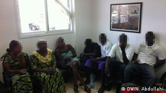 A group of African migrant talks about difficulties experienced in Malaysia; (Photo: DW/N. Abdullahi)