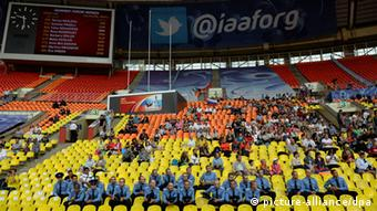 Spectators follow in the stand the morning session at the 14th IAAF World Championships in Athletics at Luzhniki Stadium in Moscow, Russia, 14 August 2013. Photo: Bernd Thissen/dpa