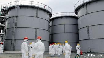 Tanks of radiation-contaminated water are seen at the Tokyo Electric Power Co (TEPCO)'s tsunami-crippled Fukushima Daiichi nuclear power plant in Fukushima prefecture, in this file photo released by Kyodo March 1, 2013. Japan's government believes radiation-contaminated water has been leaking into the Pacific Ocean from the wrecked Fukushima Daiichi nuclear plant for the past two years, an industry ministry official told reporters on August 7, 2013. Mandatory Credit REUTERS/Kyodo/Files (JAPAN - Tags: DISASTER POLITICS ENERGY ENVIRONMENT) ATTENTION EDITORS - THIS IMAGE WAS PROVIDED BY A THIRD PARTY. FOR EDITORIAL USE ONLY. NOT FOR SALE FOR MARKETING OR ADVERTISING CAMPAIGNS. THIS PICTURE IS DISTRIBUTED EXACTLY AS RECEIVED BY REUTERS, AS A SERVICE TO CLIENTS. MANDATORY CREDIT. JAPAN OUT. NO COMMERCIAL OR EDITORIAL SALES IN JAPAN. YES