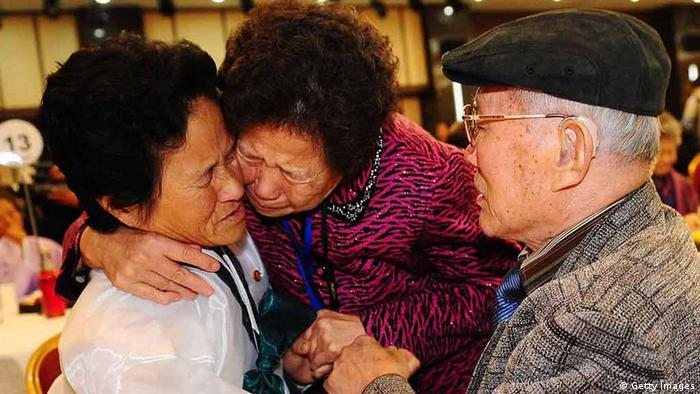 MOUNT KUMGANG, NORTH KOREA - NOVEMBER 03: (SOUTH KOREA OUT) South Korean Kim Sung-Bok (R), 90, meets his North Korean daughter Kim Hee-Sook (L), 61, during a family reunion after being separated for 60 years following the Korean War on November 3, 2010 in Mount Kumgang, North Korea. Red Cross officials from the two Koreas exchanged lists of families to be reunited - 100 names each - at a checkpoint in the border town of Kaesong in North Korea. (Photo by Kim Chang-Gil-Korea Pool/Getty Images)
