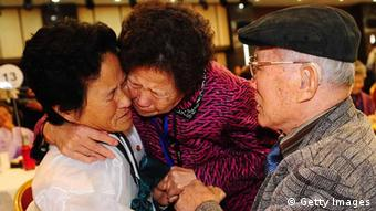 South Korean Kim Sung-Bok (R), 90, meets his North Korean daughter Kim Hee-Sook (L), 61, during a family reunion after being separated for 60 years following the Korean War on November 3, 2010 in Mount Kumgang, North Korea. (Photo: Kim Chang-Gil-Korea Pool/Getty Images)