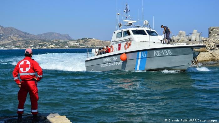 A Greek coastguard boat with migrants on board arrives at the port of Ierapetra on the Greek island of Crete on July 9, 2013. The Greek coastguard rescued 131 off the island of Crete after their boat began to take on water, port authorities said. AFP PHOTO/ GIANNIS POLITIS (Photo credit should read GIANNIS POLITIS/AFP/Getty Images)