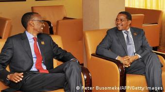 The Tanzanian and Rwandan presidents sitting and talking