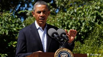 U.S. President Barack Obama makes a statement about the violence in Egypt while at his rental vacation home on the Massachusetts island of Martha's Vineyard in Chilmark August 15, 2013. REUTERS/Larry Downing (UNITED STATES - Tags: POLITICS)