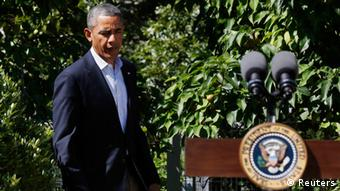 U.S. President Barack Obama walks out to make a statement about the violence in Egypt while at his rental vacation home on the Massachusetts island of Martha's Vineyard in Chilmark August 15, 2013. REUTERS/Larry Downing (UNITED STATES - Tags: POLITICS)