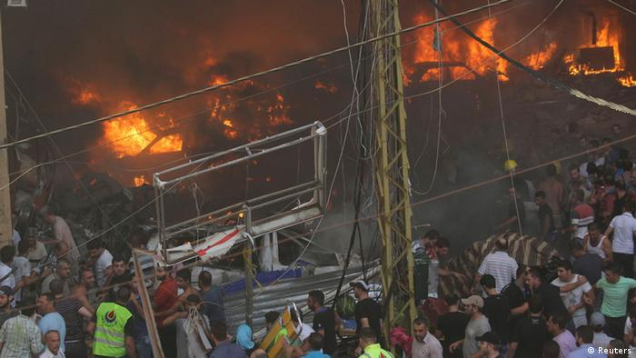 Cars burn at the site of an explosion in Beirut's southern suburbs, August 15, 2013. Rescue workers in the southern Beirut district hit by an explosion on Thursday have found nine bodies, a witness at the scene said. The powerful blast engulfed several cars in flames and also trapped people in a nearby building. REUTERS/Mahmoud Kheir (LEBANON - Tags: CIVIL UNREST POLITICS TPX IMAGES OF THE DAY)
