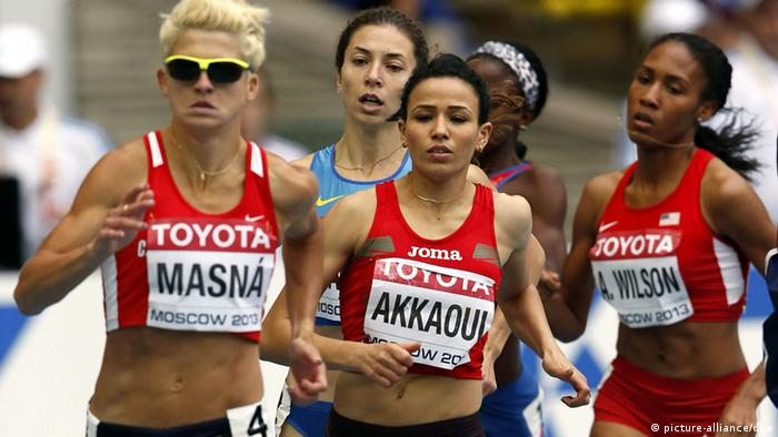 Moroccan athlete Malika Akkiaoui (C), Czech Lenka Masna (L) and US Ajee Wilson (R) compete in the women's 800m heats at the 14th IAAF World Championships at Luzhniki stadium in Moscow, Russia, 15 August 2013. EFE/Alberto Estevez