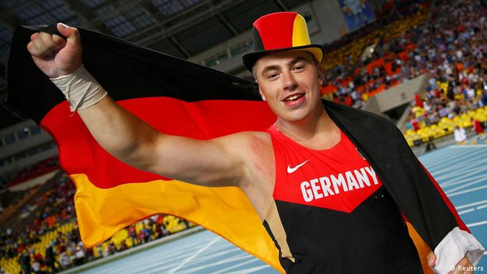 David Storl of Germany celebrates winning gold medal in the men's shot put final during the IAAF World Athletics Championships at the Luzhniki stadium in Moscow August 16, 2013. REUTERS/Kai Pfaffenbach