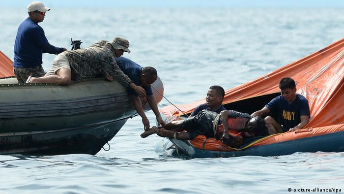 Philippine Navy personnel lift a victim from one of the floating life rafts during rescue operations on August 17, 2013 after a cargo ship collided with the ferry St. Thomas Aquinas the night before off the town of Talisay near the Philippines' second largest city of Cebu. TED ALJIBE/AFP/Getty Images