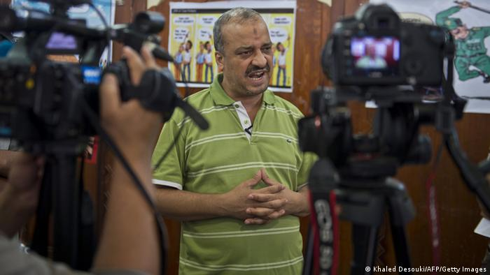 A picture taken August 4, 2013 shows Egypt's Muslim Brotherhood member Mohammed Beltagi talking with foreign media during an interview at the Rabaa al-Adawiya mosque in Cairo. AFP PHOTO / KHALED DESOUKI