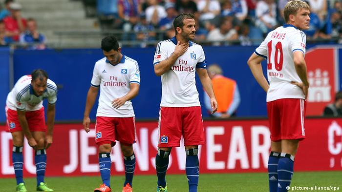 HAMBURG, GERMANY - AUGUST 17: Rafael van der Vaart (C) of Hamburg reacts during the Bundesliga match between Hamburger Sv and 1899 Hoffenheim at Imtech Arena on August 17, 2013 in Hamburg, Germany. (Photo by Martin Rose/Bongarts/Getty Images)