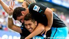 Firmino and teammates celebrate a goal against Hamburg.