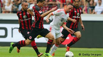 FRANKFURT AM MAIN, GERMANY - AUGUST 17: Franck Ribery (2R) of Muenchen is challenged by Carlos Zambrano, Pirmin Schwegler and Stephan Schroeck (R-L) of Frankfurt during the Bundesliga match between Eintracht Frankfurt and FC Bayern Muenchen at Commerzbank Arena on August 17, 2013 in Frankfurt am Main, Germany. (Photo by Alex Grimm/Bongarts/Getty Images)
