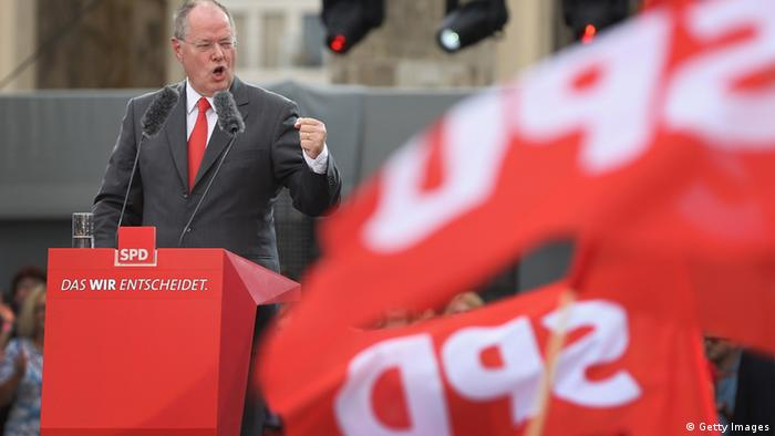 BERLIN, GERMANY - AUGUST 17: German Social Democrats (SPD) chancellor candidate Peer Steinbrueck speaks to supporters at the Deutschland Fest marking the 150th anniversary of the SPD on August 17, 2013 in Berlin, Germany. Steinbrueck is trailing incumbent Chancellor Angela Merkel and the German Christian Democrats (CDU) significantly ahead of federal elections scheduled for September 22. (Photo by Sean Gallup/Getty Images)