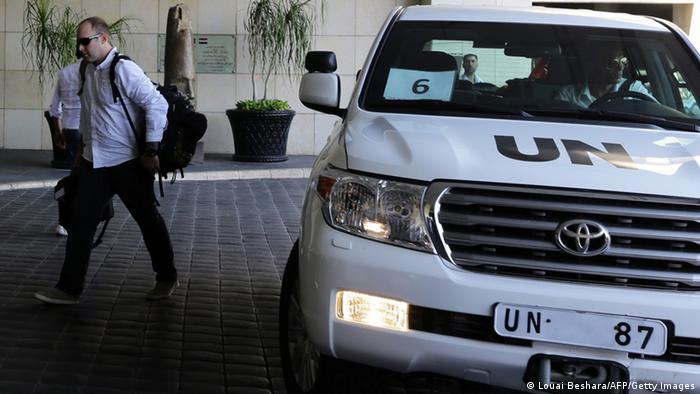 The UN chemical weapons investigation team arrives in Damascus on August 18, 2013. The UN team arrived at a hotel in the Syrian capital to begin their hard-won mission which UN officials have said will last two weeks. (Photo via LOUAI BESHARA/AFP/Getty Images)