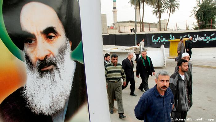 Ayatollah Ali al Sistani Shiite followers walk past a poster of their most revered leader, Grand Ayatollah Ali al-Sistani, after Friday prayers at the Buratha mosque in central Baghdad, Iraq Friday, March 4, 2005. (AP Photo/Hadi Mizban)