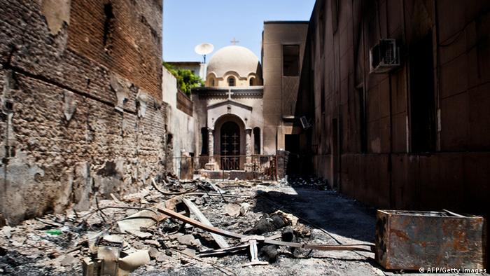 A picture taken on August 18, 2013 shows the Amir Tadros coptic Church in Minya, some 250 kms south of Cairo, which was set ablaze on August 14, 2013. Egypt's Christians are living in fear after a string of attacks against churches, businesses and homes they say were carried out by angry supporters of ousted Islamist president Mohamed Morsi. As police dispersed Morsi supporters from two Cairo squares on August 14, attackers torched churches across the country in an apparent response. AFP PHOTO / VIRGNIE NGUYEN HOANG (Photo credit should read VIRGINIE NGUYEN HOANG/AFP/Getty Images)