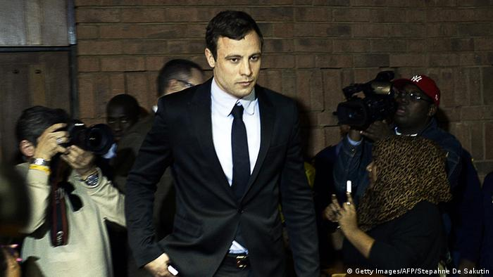 South African Olympic sprinter Oscar Pistorius (C) arrives at the Magistrate Court in Pretoria on August 19, 2013. STEPHANE DE SAKUTIN/AFP/Getty Images