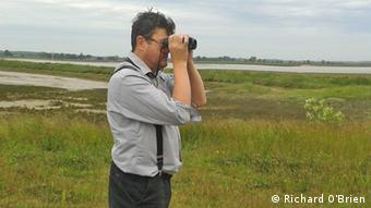Chris Tyas looking at the landscape on Wallasea