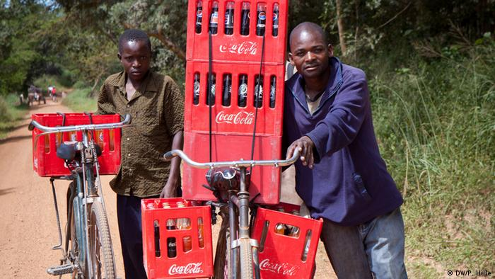 Africans transporting Coca-Cola by bicycle.