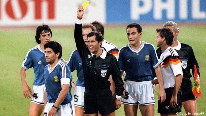 Mexican referee Ernesto Codesal Mendez gives a yellow card to Argentinian midfielder Diego Maradona (L) 08 July 1990 in Rome during the World Cup soccer final between Argentina and West Germany. The defending world champions lost 1-0 to West Germany after finishing the game with two men short. AFP PHOTO (Photo credit should read STAFF/AFP/Getty Images)