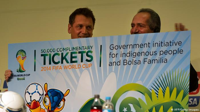 GettyImages 157086317 FIFA Secretary General Jerome Valcke (L) holds a board with Brazilian Sports Minister Aldo Rebelo as FIFA, annoucing 50,000 complementry tickets of the FIFA WC2014 for indigenous people and low income families (bolsa familia) in Sao Paulo, Brazil, on November 28, 2012. The Official Draw for the FIFA Confederations Cup Brazil 2013 will be held on December 1 in Sao Paulo. AFP PHOTO/Yasuyoshi CHIBA (Photo credit should read YASUYOSHI CHIBA/AFP/Getty Images)