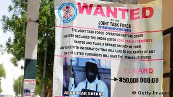 GettyImages 167846563 A poster displayed along the road shows photograph of Imam Abubakar Shekau, leader of the militant Islamist group Boko Haram, declared wanted by the Nigerian military with $320,471 reward for information that could lead to his capture in northeastern Nigeria town of Maiduguri May 1, 2013. Abubakar Shekau, leader of Islamist sect that has killed about 4,000 people since 2009 when it began its campaign of terror is Nigeria's most wanted man, who has been designated a terrorist by the US government. President Goodluck Jonathan has approved the constitution of a Presidential Committee to constructively engage key members of Boko Haram and define a comprehensive and workable framework for resolving the crisis of insecurity in the country. AFP PHOTO/PIUS UTOMI EKPEI (Photo credit should read PIUS UTOMI EKPEI/AFP/Getty Images)