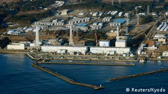 An aerial view shows Tokyo Electric Power Co.'s (TEPCO) tsunami-crippled Fukushima Daiichi nuclear power plant in Fukushima Prefecture in this March 11, 2013 file photo. The operator of Japan's crippled Fukushima nuclear plant said on August 20, 2013 it believes about 300 tonnes of highly contaminated water has leaked from a storage tank designed to hold overflows from the site. Picture taken March 11, 2013.