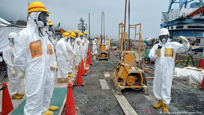 This photo taken on August 6, 2013 shows local government officials and nuclear experts inspecting a construction site to prevent the seepage of contamination water into the sea, at Tokyo Electric Power's (TEPCO) Fukushima Dai-ichi nuclear plant in Okuma, Fukushima prefecture. Japan will accelerate efforts to prevent more radioactive groundwater from seeping into the ocean at the crippled Fukushima nuclear plant, government officials said on August 7, as critics slam its operator's handling of the issue. JAPAN OUT AFP PHOTO / JAPAN POOL via JIJI PRESS (Photo credit should read JAPAN POOL/AFP/Getty Images)
