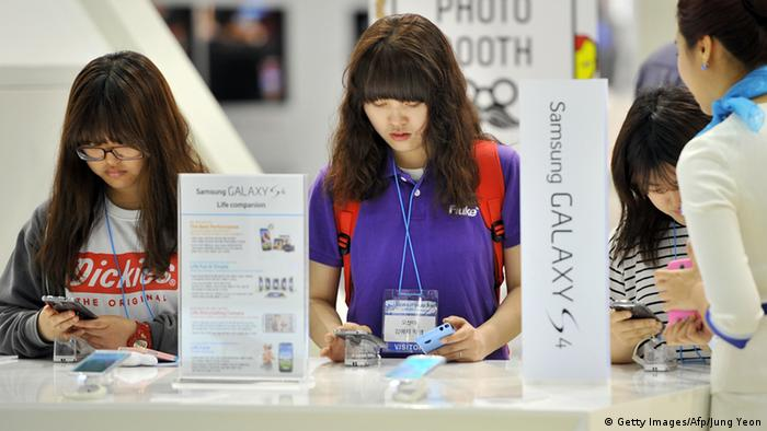 Visitors testing Samsung smartphones JUNG YEON-JE/AFP/Getty Images