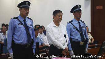 Disgraced Chinese politician Bo Xilai stands trial inside the court in Jinan, Shandong province August 22, 2013, in this photo released by Jinan Intermediate People's Court. Fallen Chinese politician Bo appeared in public for the first time in more than a year on Thursday to face trial in eastern China, the final chapter of the country's most politically charged case in more than three decades. REUTERS/Jinan Intermediate People's Court/Handout via Reuters (CHINA - Tags: POLITICS CRIME LAW TPX IMAGES OF THE DAY) ATTENTION EDITORS - THIS IMAGE WAS PROVIDED BY A THIRD PARTY. FOR EDITORIAL USE ONLY. NOT FOR SALE FOR MARKETING OR ADVERTISING CAMPAIGNS