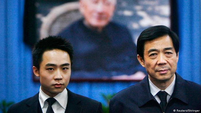 China's then Chongqing Municipality Communist Party Secretary Bo Xilai (R) and his son Bo Guagua stand in front of a picture of his father Bo Yibo, former vice-chairman of the Central Advisory Commission of the Communist Party of China, at a mourning hall in Beijing in this January 18, 2007 file photo. Fallen Chinese politician Bo appeared in public for the first time in more than a year on August 22, 2013 to face trial in eastern China, the final chapter of the country's most politically charged case in more than three decades. REUTERS/Stringer (CHINA - Tags: POLITICS CRIME LAW) CHINA OUT. NO COMMERCIAL OR EDITORIAL SALES IN CHINA