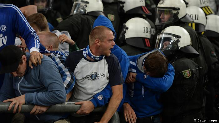 Policemen and Schalke fans clash during the UEFA Champions League play-off first leg football match Schalke 04 vs Greece's PAOK Salonika in Gelsenkirchen, western Germany on August 21, 2013. STOLLARZ/AFP/Getty Images